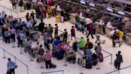 HD Time Lapse : Tourists in a row to check in at the airport video