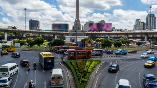 Time Lapse - Traffic at victory monument in Bangkok city with zoom shot video