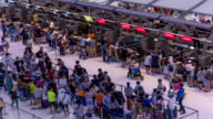 HD Time Lapse : Travelers at airport check in zone video