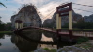 Time Lapse :Traveller walking old bridge inrainforest nature video