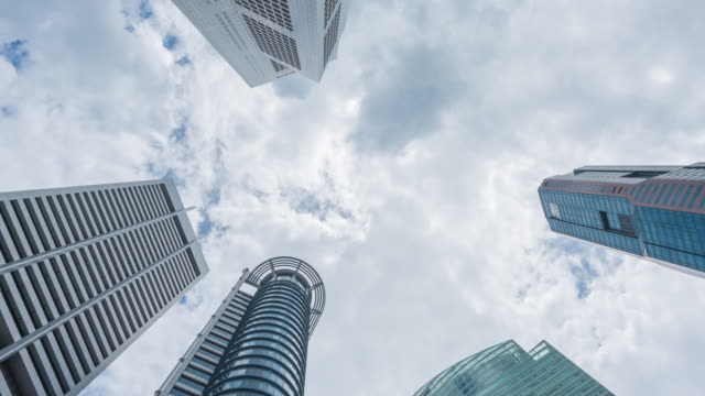4K Time Lapse : vertical view of high rise skyscraper buildings in Singapore city. modern city business district background video