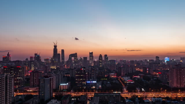 Time Lapse- View of Beijing Skyline, Dusk to Night Transition (WS HA PAN) video