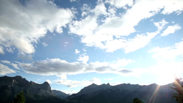 Time lapse view of clouds above mountains video