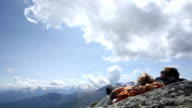 Time lapse view of clouds lifting above sleeping hikers video
