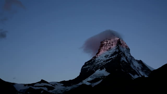 Time lapse view of clouds swirling around Matterhorn video
