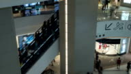 Time lapse view of people pedestrian traffic on the escalator in the big multi-level shopping mall video
