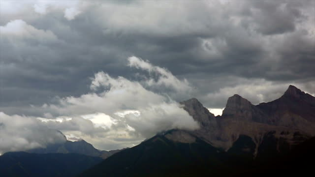 Time lapse view of storm clouds building above mountains video