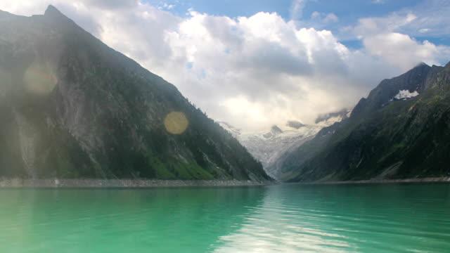 Time lapse water floating on mountain glacier reservoir Schlegeisspeicher near Mayrhofen Zillertal region of Austrian Alps video