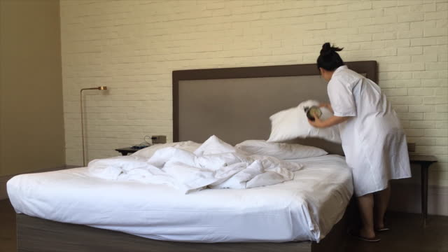 time lapse: woman making bed clean and tidy video
