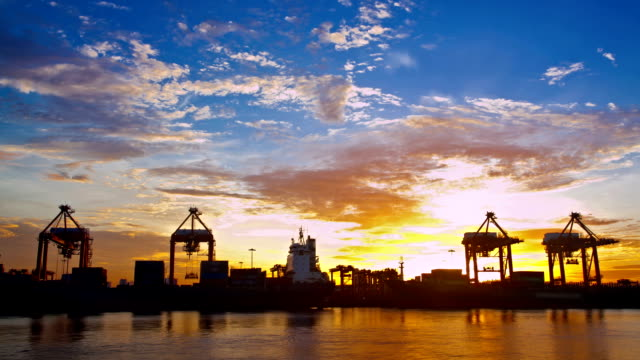 Time lapse Working at Trading port Terminal with Container sunrise video