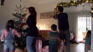 Time Lapse Young Family Putting Up Christmas Decorations video