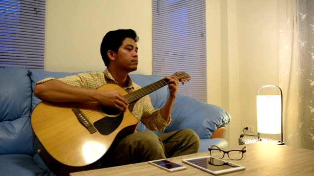 Time lapse Young man playing guitar relax after time out video