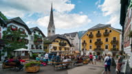 Time Lapse,Crowd waking at Hallstatt town centre, Austria video