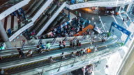 Time-lapse 4K:  Crowd on the escalator in shopping mall video