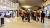 Time-lapse 4K: Traveler Crowd at Airport Departure boarding Hall video