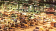 4K time-lapse: aerial shot warehouse Port background in Singapore night video