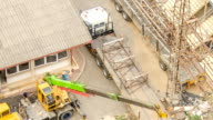 HD Time-lapse: Aerial view of working truck in electrical Construction site video