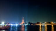 Timelapse at night of Wat Arun with lighting show near Chaopraya river video
