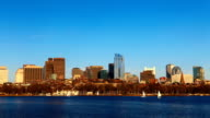 Timelapse Boston city center with sailboats in foreground video