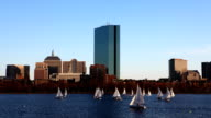 Timelapse Boston city center with sailboats in front video