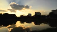 Time-lapse: Cityscape Silhouette with Sunbeam Reflection in the River video