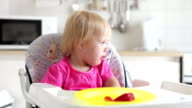 TimeLapse Clip Of  Girl Sitting In High Chair Eating video