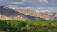 4K Time-lapse: clouds and shadow over himalayan mountain range with thiksey monastery on the mountain from shey palace, Ladakh province, India video