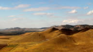 Timelapse clouds over a mountain range and nature reserve video