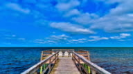 Time-lapse Cloudscape of Ocean Pier with Chairs in HD video