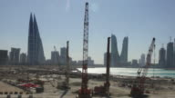 Timelapse: Construction Site in Bahrain with City Skyline on the background. Camera pan. video