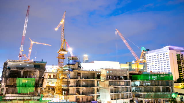 HD Time-lapse: Construction Site working at dusk panning video