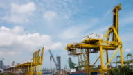 4K Time-lapse : Container Cargo freight ship working crane bridge in shipyard video