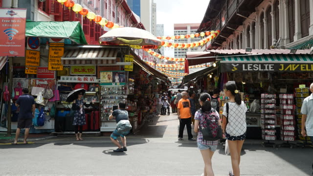 Timelapse crowded people in china town at singapore video