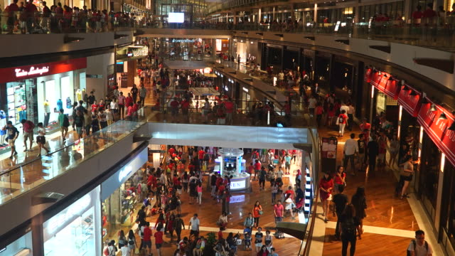 Time-lapse crowded people in shopping mall at singapore video