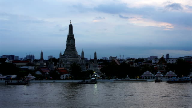 Time-lapse Day to Night Top view Was Arun and traffic on Chao Phraya river Bangkok,Thailand ;pan effect video