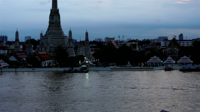 Time-lapse Day to Night Top view Was Arun and traffic on Chao Phraya river Bangkok,Thailand ;tint effect video