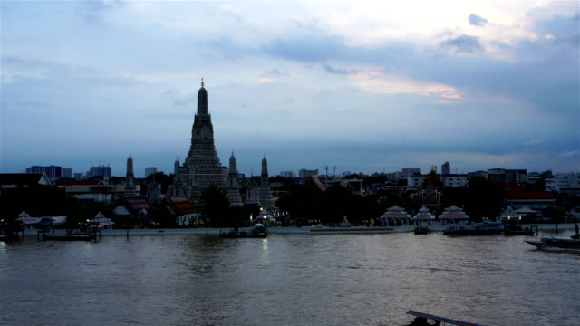 Time-lapse Day to Night Top view Was Arun and traffic on Chao Phraya river Bangkok,Thailand video