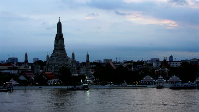 Time-lapse Day to Night Top view Was Arun and traffic on Chao Phraya river Bangkok,Thailand ;zoom effect video