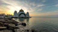 timelapse footage of a beautiful sunrise at Melaka Strait Mosque with moving and changing color clouds. video