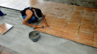 Time-lapse footage of floor tiling video