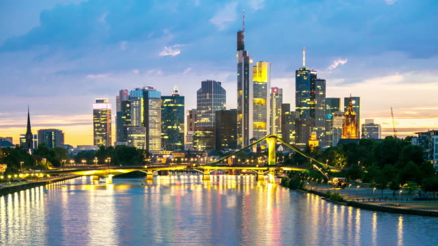 4K Time-lapse: Frankfurt Cityscape along the main river at dusk video