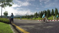 Time-lapse group of cyclists On street for campaign video