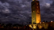 Timelapse Koutoubia Mosque in Marrakech at sunset and night on background of clouds, Morocco video