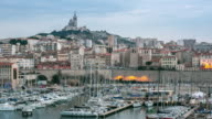 Time-lapse: Marseille city with old Vieux Port sunset video