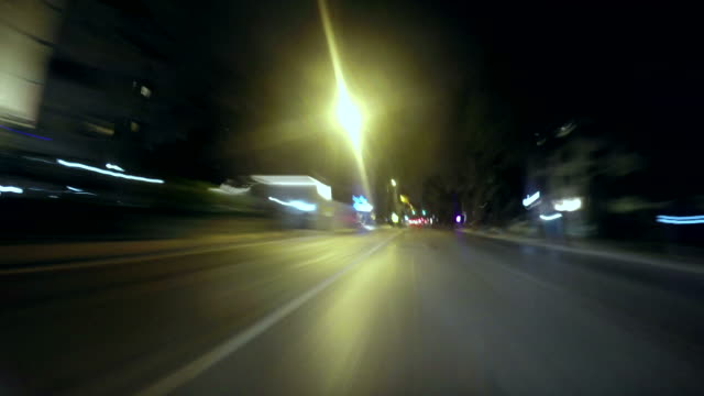 Timelapse motion of urban road traffic at night. Car point of view I video