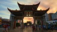 Timelapse Movie of Sunset at Golden Horse memorial Archway on Jinbi Road, KUNMING, CHINA video