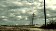 Timelapse of a field with clouds and telephone poles video