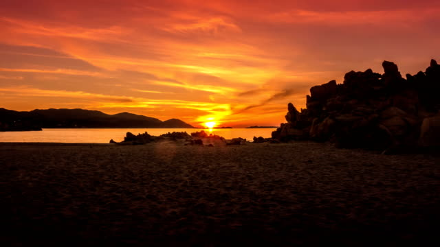 Timelapse of a Sunrise on a Wild Beach by the Sea video