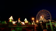 Time-lapse of Amusement park at night with ferris wheel video