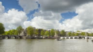 Timelapse of boats moving over the River Amstel in Amsterdam video